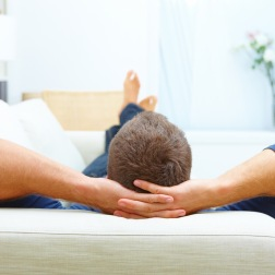 Portrait of male resting at home on his couch